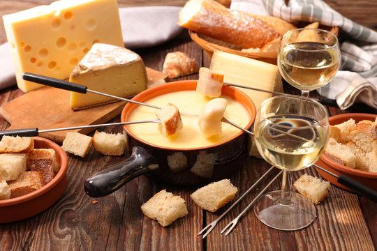 cheese fondue with wine and bread- traditional french dish