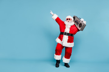 Full length body size view of his he nice cool trendy stylish fat cheerful cheery glad excited bearded Santa carrying tape player dancing isolated over blue turquoise pastel color background