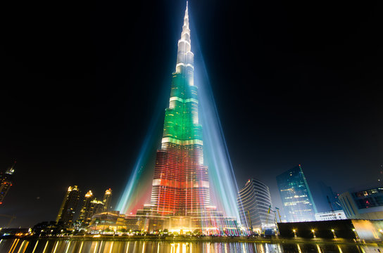 DEC 03 -DUBAI, UAE:  Burj Khalifa Tower floodlit in the white, green and red colours of the flag of the United Arab Emirates to celebrate the 42nd National Day. on the third of december of  2013