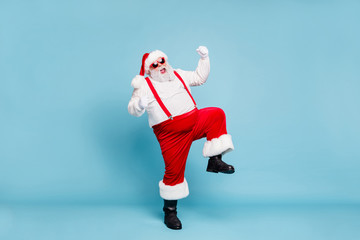 Full body photo of crazy funny funky fat santa with big belly raise fists scream yeah enjoy...