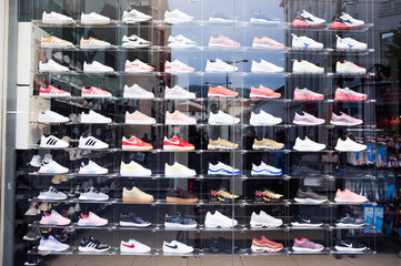 NICE, FRANCE-JUNE 04,2018: footlocker shop  window with a row of nike shoes