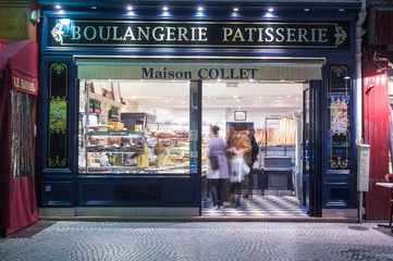 PARIS,FRANCE-NOV.18,2009: people make shopping in a Typical boulangerie in Paris photographed at night in Rue Montorgueil, Paris.France