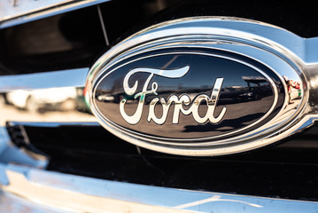 Valencia, Spain - January 13, 2019: Logo of the car manufacturer Ford in a parked vehicle.