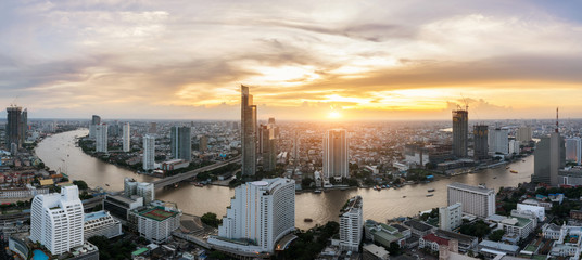 Landscape of Chao phraya river in Bangkok city in evening time with bird view. Bangkok City at night time, Hotel and resident area in the capital of Thailand. Asian tourism, modern city life,