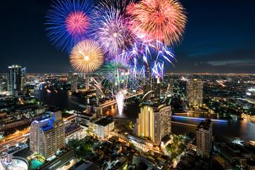 Beautiful fireworks celebrating new year along Chao Phraya River in Bangkok, Thailand