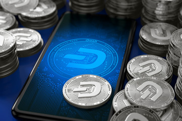 Smartphone with Dash coin icon (2019 updated logo) on-screen among piles of silver Dash coins. 3D rendering