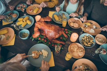 Cropped served table homemade fresh delicacy turkey meal dishes domestic recipe. Nice lovely big full family having lunch luncheon gathering meeting in house restaurant catering