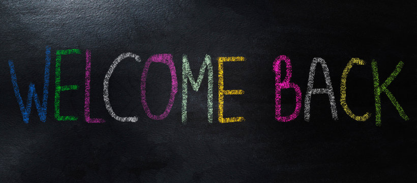 handwriting with colorful chalk welcome back concept