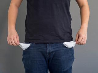 man showing his empty pockets.No money concept