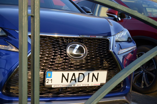 Lexus NX 300h front part with company logo and name NADIN on license plate number
