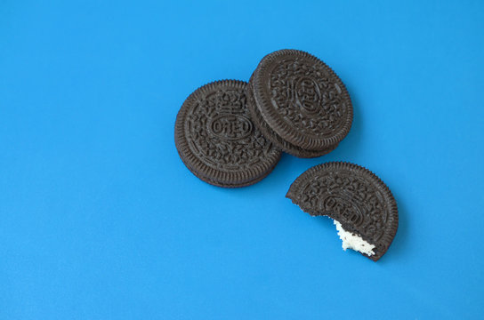 Many OREO sandwich cream biscuits on blue background