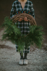 Crop woman with conifer wreath