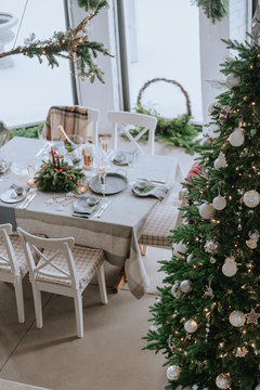 Festively decorated room and Christmas table for dinner