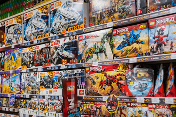 Minsk, Belarus - April 27, 2019: Variety of construction toys on shelves in a store. The Lego Group is the major manufacturer of construction toys in the world