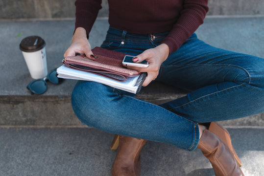 Close up of contemporary Latino woman with notepad outdoors