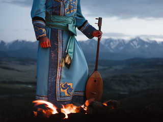 TIbetan or Altay man playing on lute dranyen