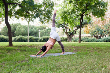 Athletic woman in yoga asana on mat
