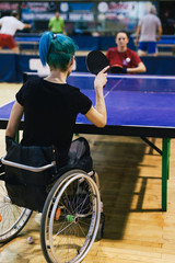 Woman in wheelchair playing table tennis