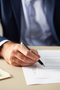Businessman reading paper contract
