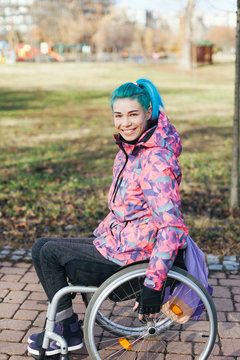 Woman in wheelchair outdoor