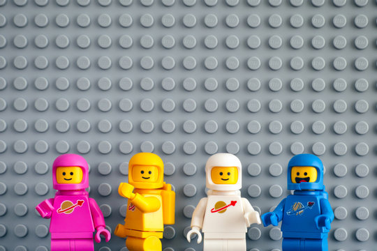 Tambov, Russian Federation - February 24, 2019 Four Lego astronaut minifigures against gray baseplate background. The LEGO Movie 2.