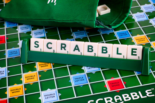 Tambov, Russian Federation - May 02, 2018 Scrabble Board Game. Word Scrabble from letter tiles in tile rack on game board with drawstring letter bag.