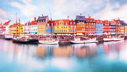 Foto auf AluDibond Schiff Unmatched magical fascinating landscape with boats in a famous Nyhavn in the capital of Denmark Copenhagen. Exotic amazing places. Popular tourist atraction.