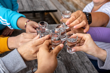 toast with friends with spirits shots