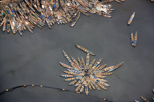 Aerial view of fishing boats moored together in the port of Tema, Greater Accra, Ghana