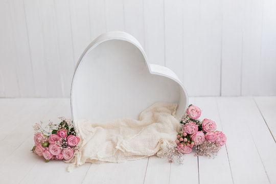heart of wood decorated with roses. basket for newborn photo shoot. pink rose. heart