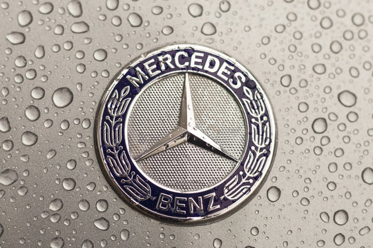 Kiev, Ukraine - 03 NOVEMBER, 2017: Close-up emblem of modern luxury Mercedes-Benz car with grey wet hood