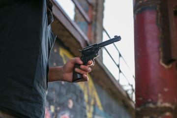 Foto op Canvas Jacht hand holding a gun replica at gunflght