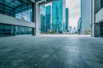 Fotomurales - Panoramic skyline and buildings with empty square floor.