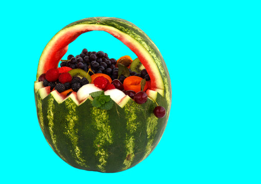 Handmade basket of watermelon isolated on blue background.