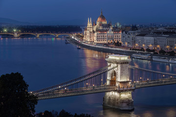Budapest, Hungary - Aerial skyline view of Budapest with the famous illuminated Szechenyi Chain Bridge and Hungarian Parliament building at dusk