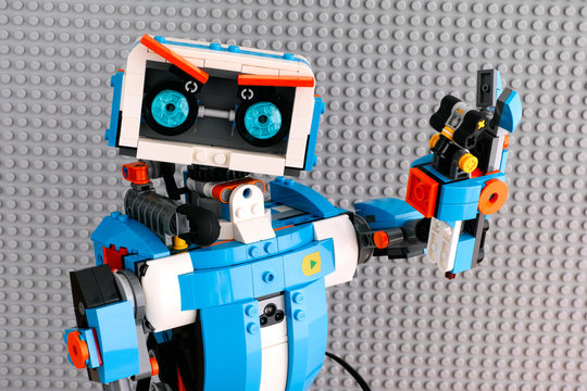 Tambov, Russian Federation - July 27, 2018 Lego BOOST robot with gray baseplate background.