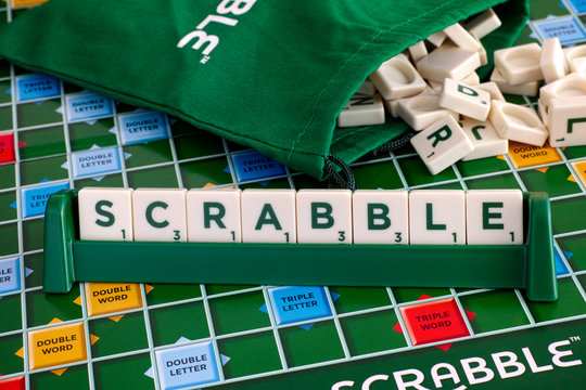 Tambov, Russian Federation - May 02, 2018 Scrabble Board Game. Word Scrabble from letter tiles in tile rack on game board with drawstring letter bag. Studio shot.
