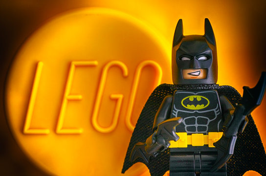 Tambov, Russian Federation - May 20, 2018 Lego Batman minifigure against yellow background with word LEGO.