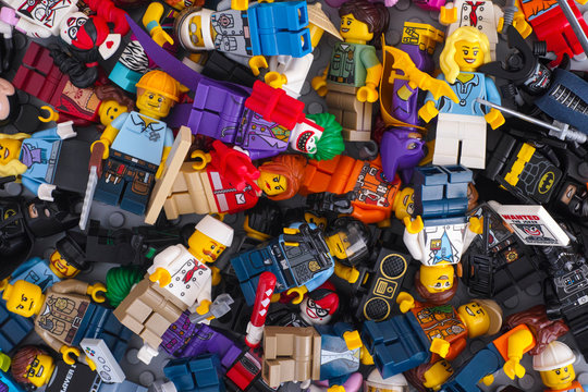 Tambov, Russian Federation - February 05, 2018 Heap of Lego minifigures. Full frame.