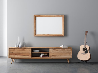 Horizontal Wooden Frame poster Mockup hanging above console and acoustic guitar