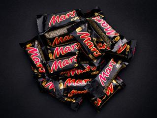 Tambov, Russian Federation - November 15, 2017 Heap of Mars minis candy bars on black background.