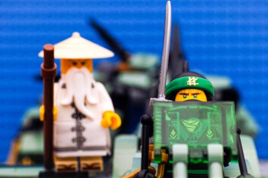 Tambov, Russian Federation - August 19, 2017 Lego Ninjago Movie. The Green Ninja and Wu flying on Green Ninja Mech Dragon. Studio shot.