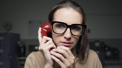 Fotomurales - Scared woman receiving bad news on the phone