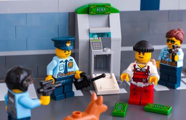 Tambov, Russian Federation - June 03, 2017 Lego policemen arrested thief who hack ATM. Studio shot.