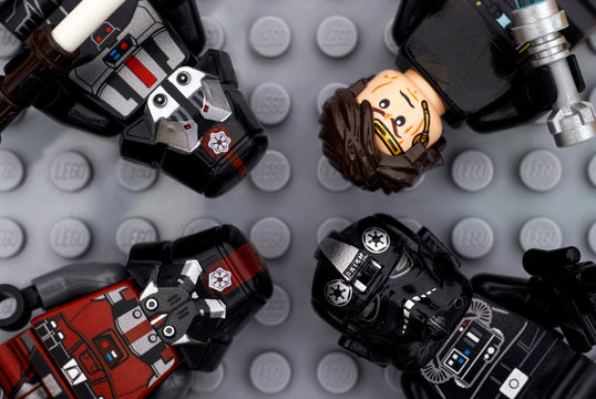 Tambov, Russian Federation - July 06, 2016 Four Lego Star Wars minifigures - Anakin Skywalker, TIE Pilot, black and red Sith troopers - on Lego gray baseplate background. Studio shot.