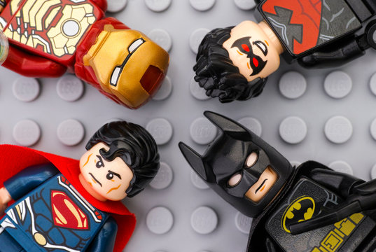 Tambov, Russian Federation - May 12, 2016 Four Lego Super Heroes - Iron Man, Batman, Superman, Nightwing - minifigures on Lego gray baseplate background. Studio shot.