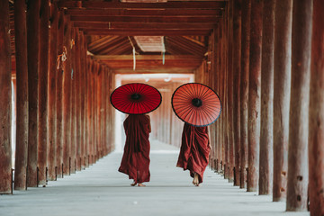 Portrait of  local little buddhist monks. In myanmar childrens start training for becoming monks at the age of 7