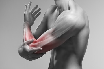 Man holds his elbow by the hand. Pain zone in the arm and bone illustration