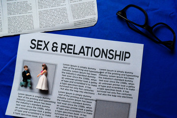 Sex and Relationship text in headline isolated on blue background. Newspaper concept