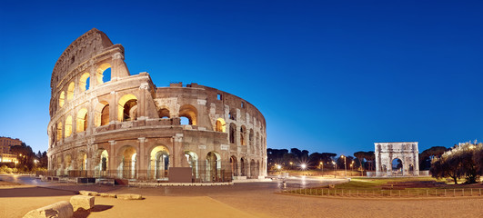 Colosseum (Coliseum) in Rome, Italy, at nigh, panoramic image